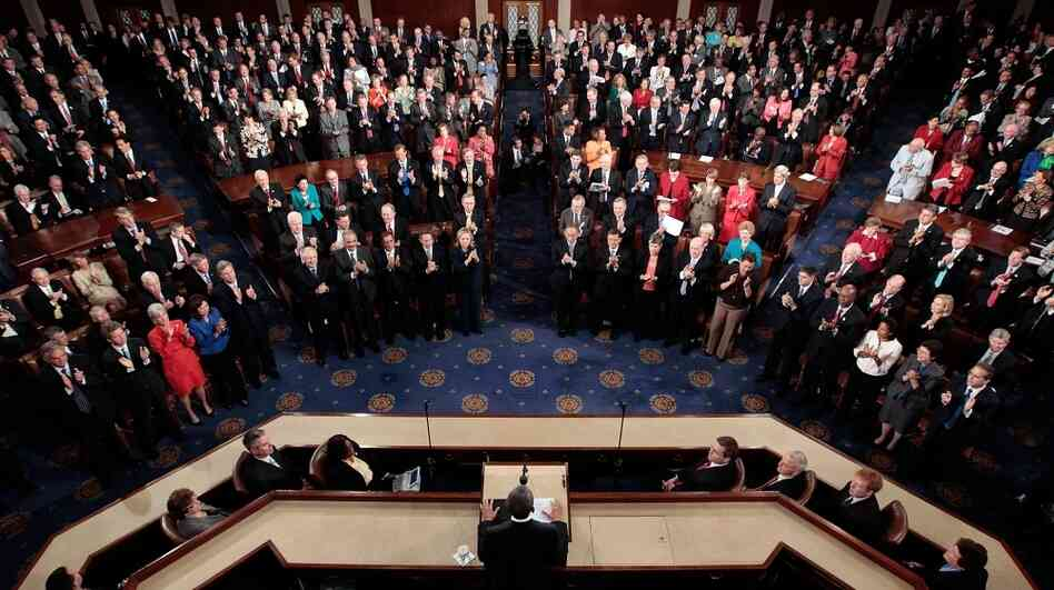 Members of the U.S. Congress applaud during a joint session at the U.S. Capitol. Nearly 50 percent of those in Congress are millionaires and may be affected by President Obama's tax proposal.
