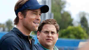 Brad Pitt, left, plays Billy Beane, the general manager of the Oakland A's, in the movie Moneyball. His assistant Peter Brand is played by Jonah Hill.