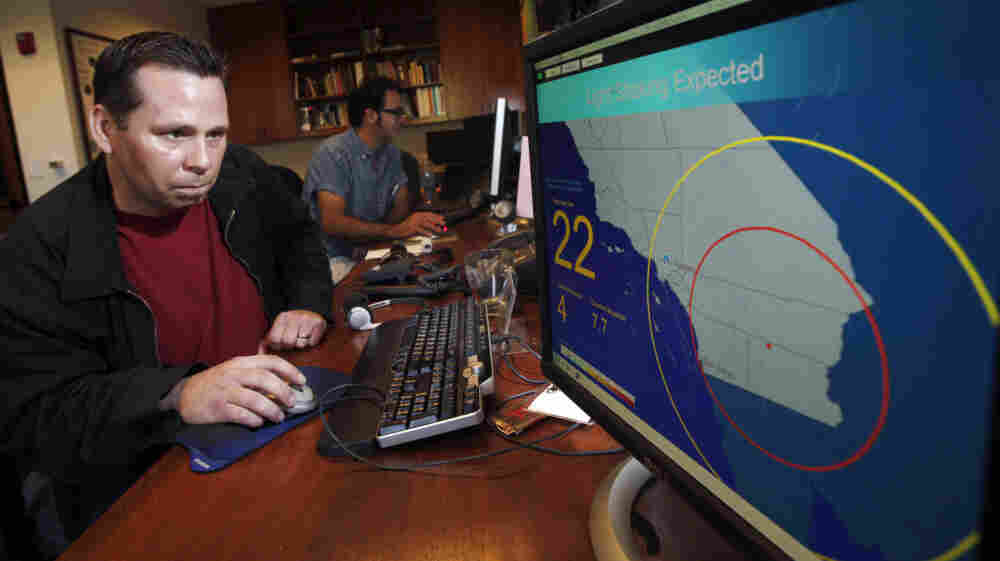 Anthony Guarino Jr., a seismic analyst at the California Institute of Technology, demonstrates an early earthquake warning system in Pasadena, Calif.