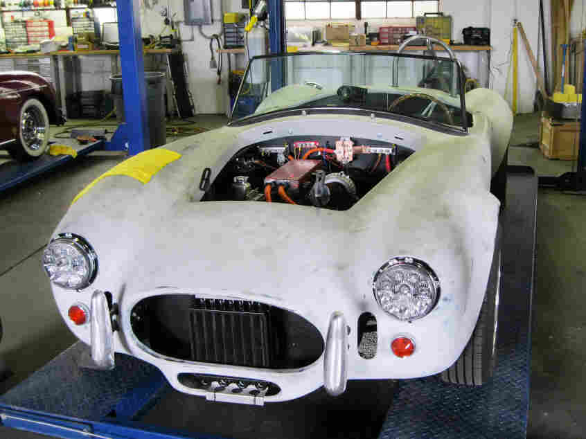Jack Rickard and Brian Noto of EVTV are converting this replica 1966 AC Cobra to run entirely on batteries. The two host an online video series explaining how to convert a gas-guzzling road warrior into an all-electric vehicle.