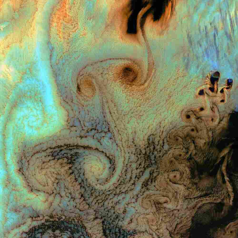 Air flows create sheets of von Karman vortices as they cross Alaska's Aleutian Islands. This image was acquired by the Landsat 7 Enhanced Thematic Mapper. View larger version.