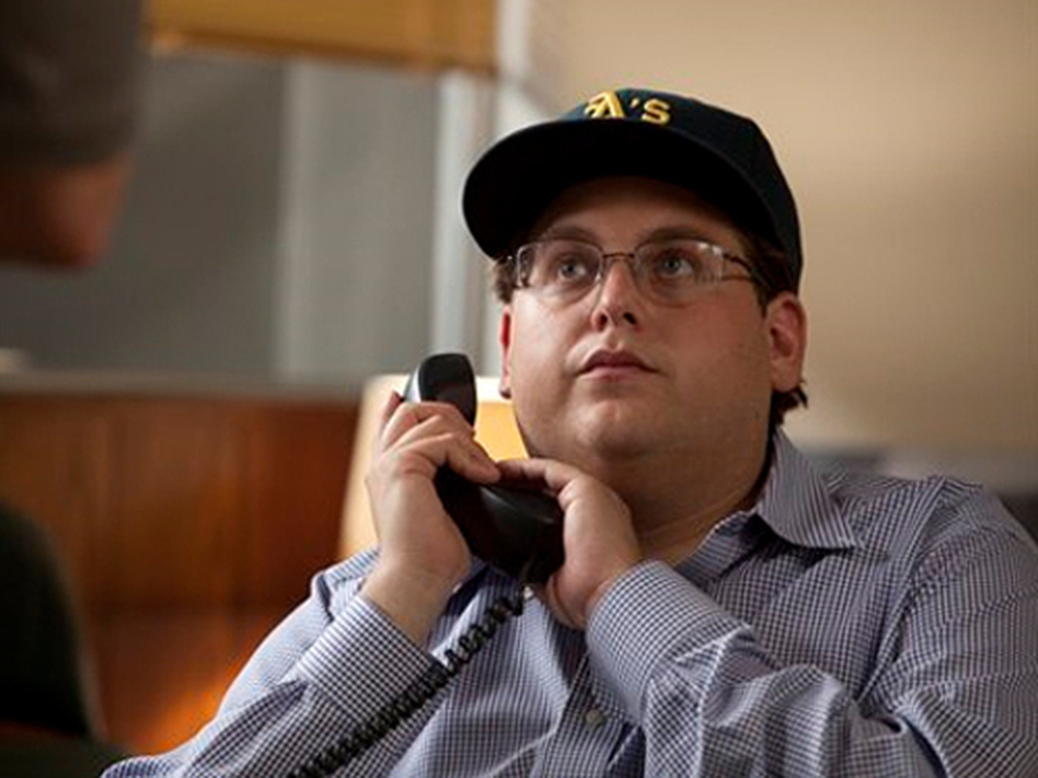 Jonah Hill takes on a surprisingly more serious role than his previous work as Peter Brand, an overachieving Ivy League geek who likes to crank statistics on everyone. (AP Photo/Columbia Pictures)