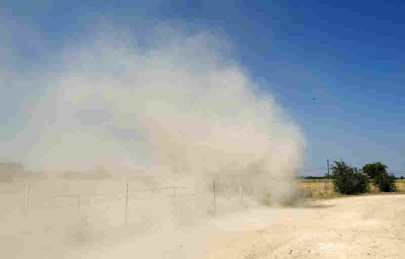 A whirlwind kicks up dust in Garfield on a day that saw a high temperature of 106.