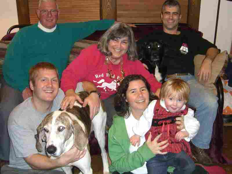 Annmarie sits in the front with her daughter, her husband and her beloved dog, Hound.