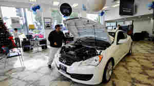 Despite the availability of cheap loans, in some places, people are cautious when it comes to buying new cars. Here, workers display a car at a California Hyundai dealership earlier this year.