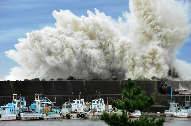 Surging waves hit against the breakwater in Udono in a port town of Kiho, Mie Pr