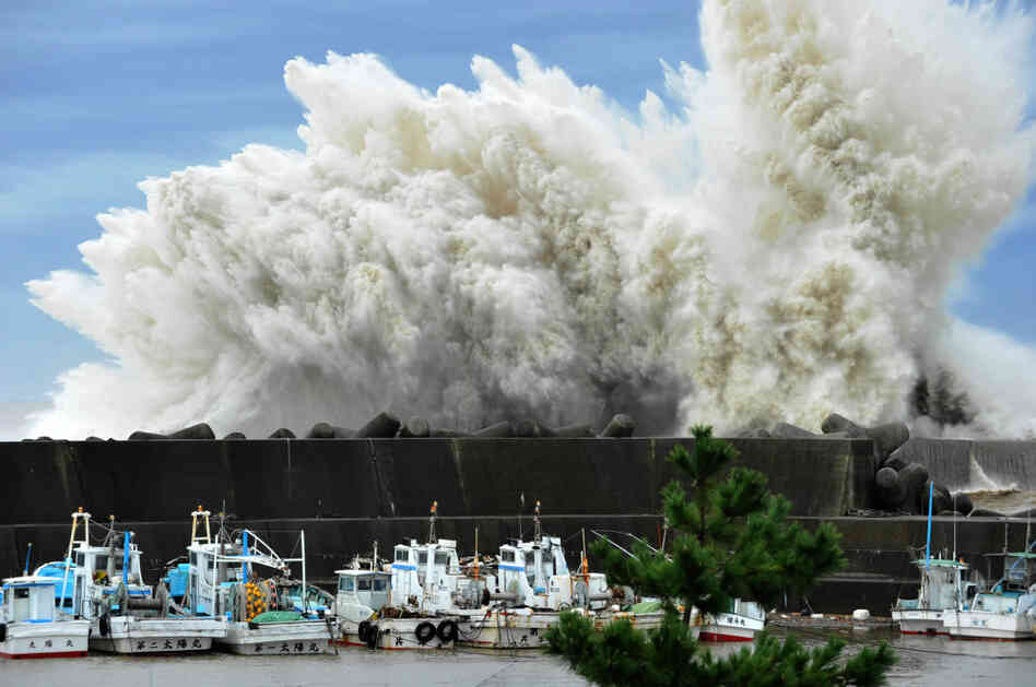 Surging waves hit against the breakwater in Udono in a port town of Kiho, Mie Prefecture, central Japan.