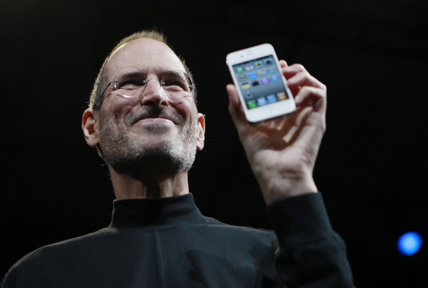 Steve Jobs holds up an iPhone at the Apple Worldwide   Developers Conference in San  Francisco in June 2010.