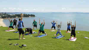 "Contestants from NBC's ""The Biggest Loser"" do yoga in Auckland, New Zealand."