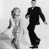 Chubby Checker twists with a friend.