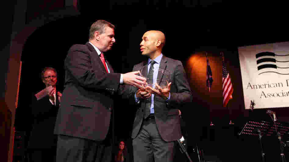 Indianapolis Mayor Greg Ballard presents Aaron Diehl with the 2011 Cole Porter Fellowship.