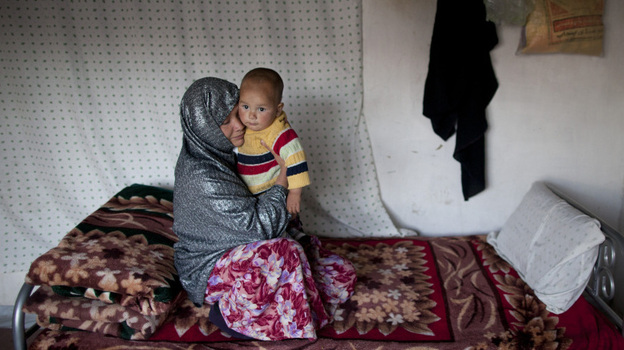 Sakina sits with her 18-month-old son, Shafiq, at a women's shelter in Bamiyan, in central Afghanistan, last October. Sakina spent seven months in prison for leaving a forced marriage. The Afghan government recently backed down from a plan to take control of women's shelters, and women's groups are hailing it as a victory. (Getty Images)