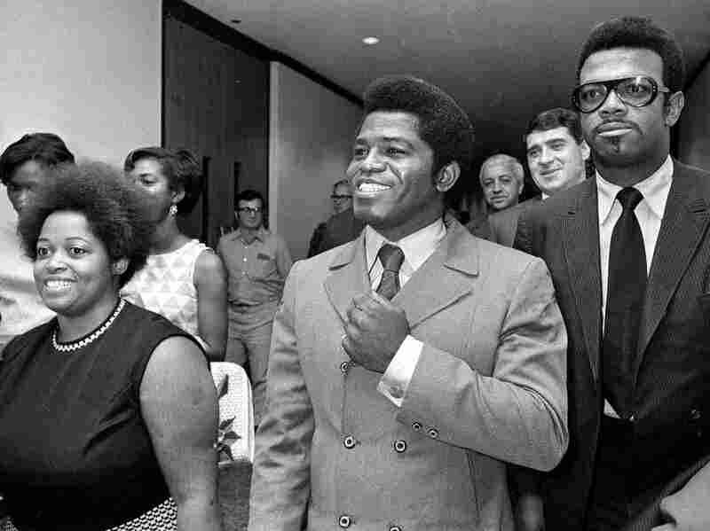 Soul singer James Brown (center) is seen in California in this 1969 file photo. A few years earlier, Brown paid a visit to Virginia, where he gave some advice to Earl Reynolds Jr.
