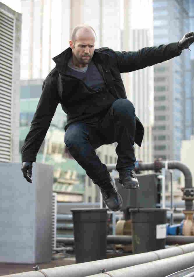 Statham plays his usual charismatic stoic — leaping tall buildings and wooing stunning women as he chases down the bad guys.
