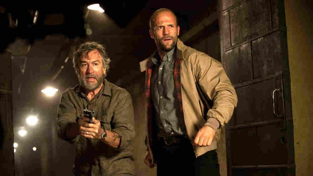 Misfire: Robert DeNiro (left) sleepwalks his way through Killer Elite, also starring Jason Statham.