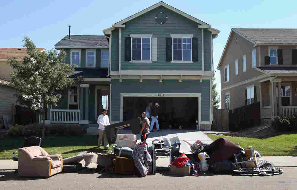 An eviction team removes furniture during a home foreclosure in Longmont, Colorado.