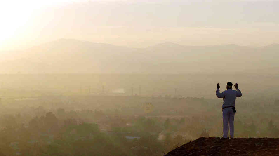Living in the past: A man greets the spring equinox on top of a pyramid at Teotihuacan, Mexico.