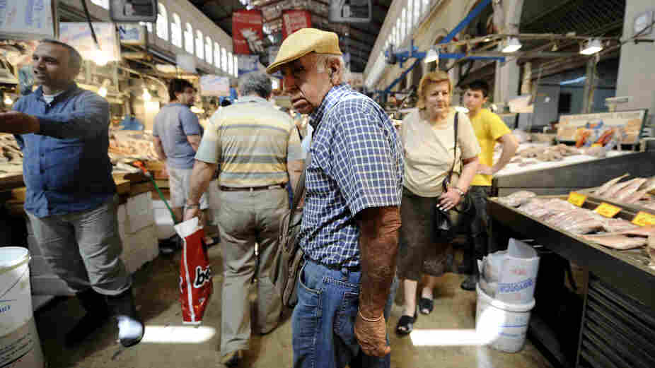 A pensioner shops in Athens' central market on May 12. The rapidly aging population in Europe will increasingly strain national budgets across the continent, where more retirees will be depending on fewer workers.