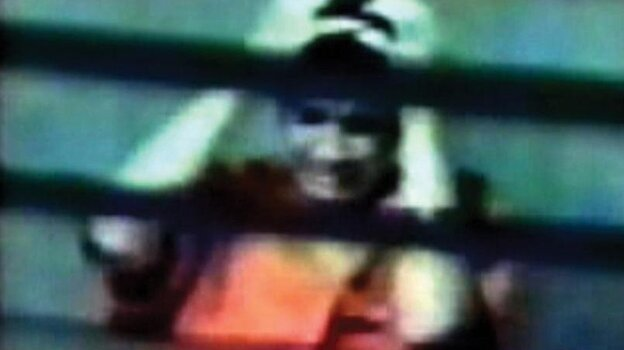 This photo, taken from a 2003 U.S. Department of Defense surveillance video, was released by Omar Khadr's lawyers. Khadr (pictured) is in an interrogation room at the Guantanamo Bay detenti