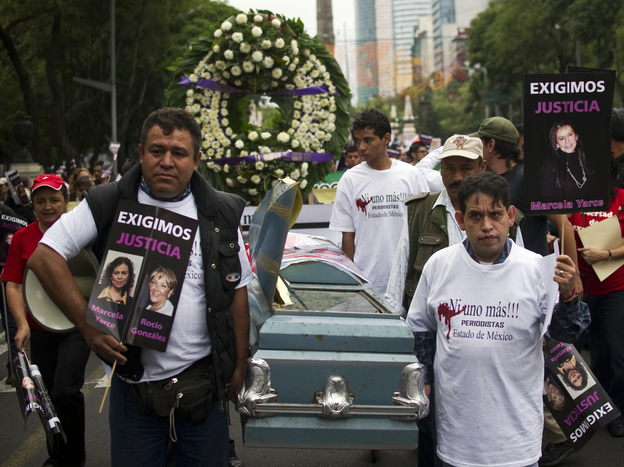 Mexican journalists march in a protest against violence directed against the media on Sept. 11, in Mexico City. Drug cartels, which have been responsible for many of the deaths, are now intimidating social media sites.