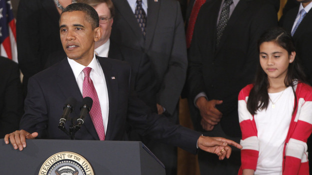 President Obama appeared with sixth-grader Keiry Herrera of Graham Road Elementary School in Falls Church, Va., as he spoke about No Child Left Behind on Friday at the White House. (AP)
