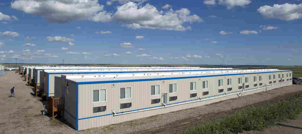 "The North Dakota oil boom has produced a housing shortage — and workers are living in company-owned ""man camps"" like this one outside the town of Williston."