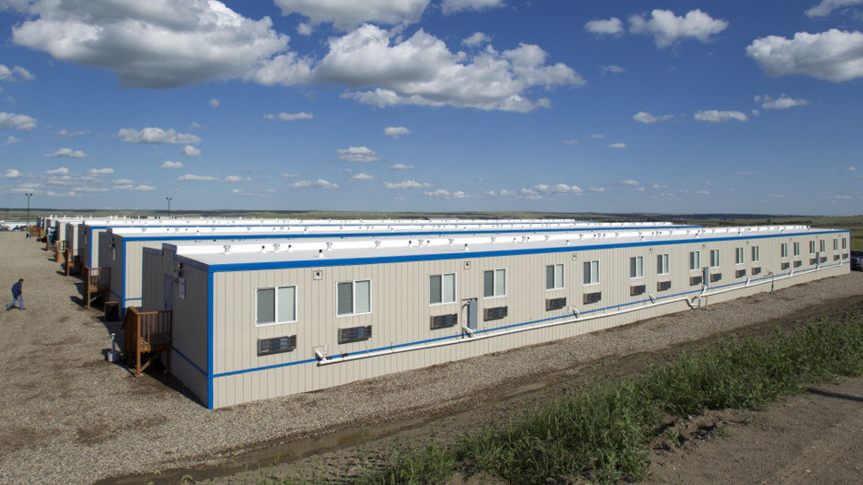 "The North Dakota oil boom has produced a housing shortage — and workers are living in company-owned ""man camps"" like this one outside the town of Williston. (AP)"