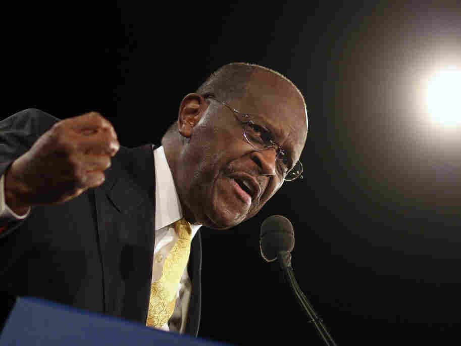 Herman Cain speaks prior to Florida's straw poll at the Orange County Convention Center on Saturday in Orlando.  Cain was a clear winner in the non-binding poll.