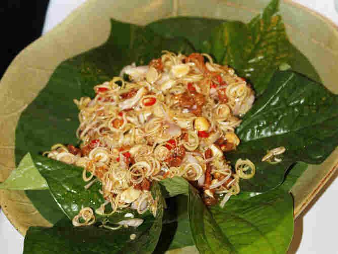 A freshly tossed Thai lemongrass salad is served on betel leaves at Naj, a Bangkok restaurant
