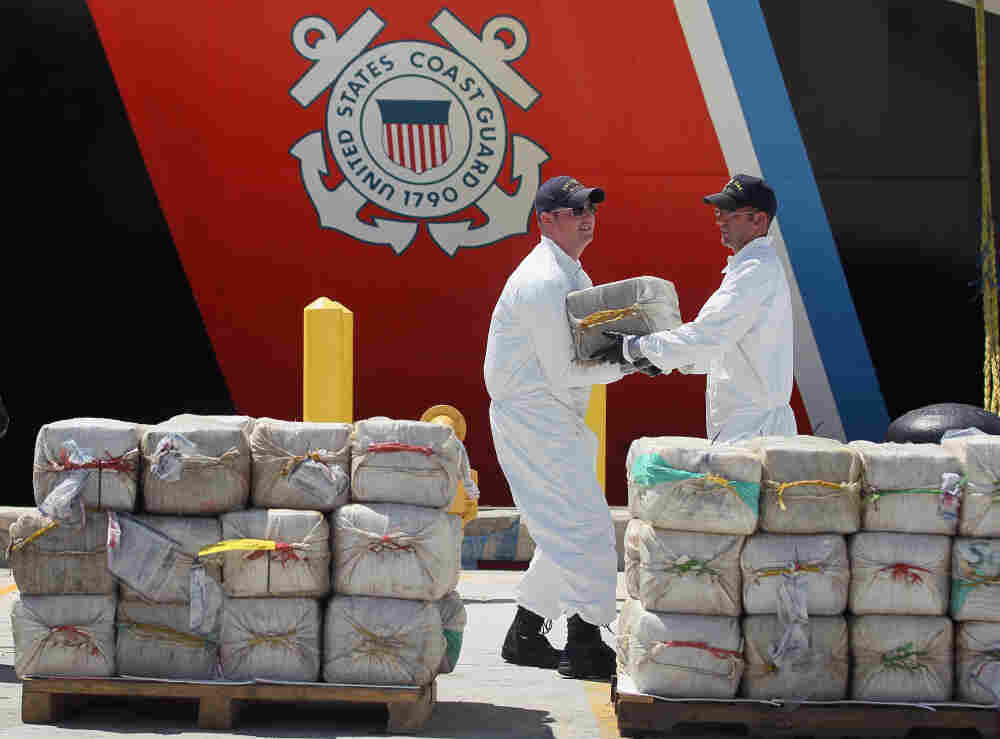 U.S. Coast Guard crew members from the Cutter Oak offload some of the 15,000 pounds of cocaine confiscated and worth more than $180 million. The picture was was taken in Miami Beach, Florida in August.