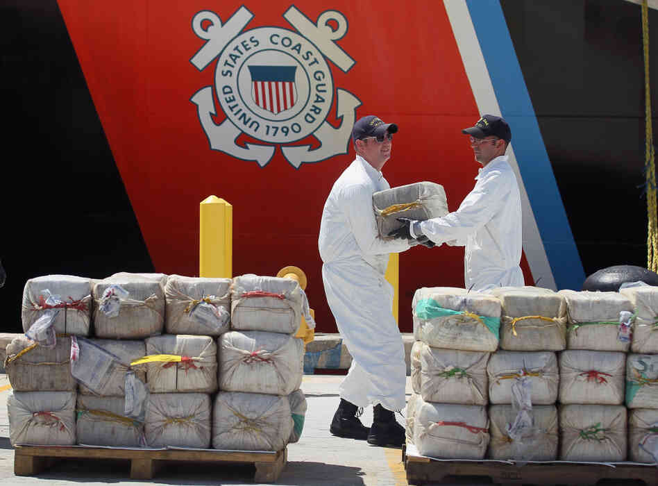 U.S. Coast Guard crew members from the Cutter Oak offload some of the 15,000 pounds of cocaine confiscated and worth more than $180 million. The picture was was taken in Miami B