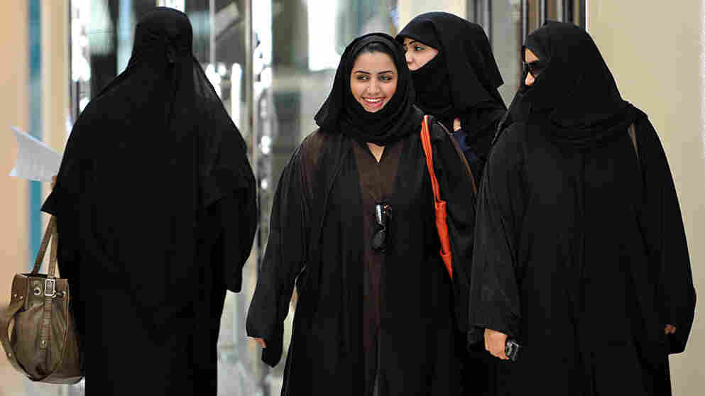 Saudi women walk inside the 'Faysalia' mall in Riyadh , on September 26, 2011, a day after Saudi Arabia's King Abdullah bin Abdulaziz al-Saud granted women the right to vote and run in municipal elections.