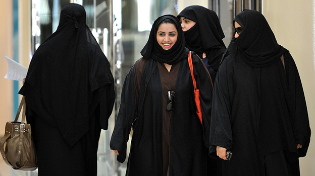 Saudi women walk inside the 'Faysalia' mall in Riyadh , on September 26, 2011, a day after Saudi Arabia's King Abdullah bin Abdulaziz al-Saud granted women the right to vote and run in municipal elections. (AFP/Getty Images)