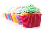 Row of brightly-colored cupcakes.