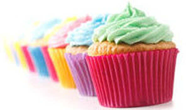 Row of brightly-colored cupcakes. (iStockphoto.com)