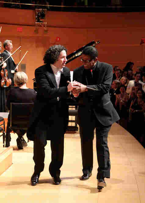 Dudamel and Hancock share a moment walking offstage.