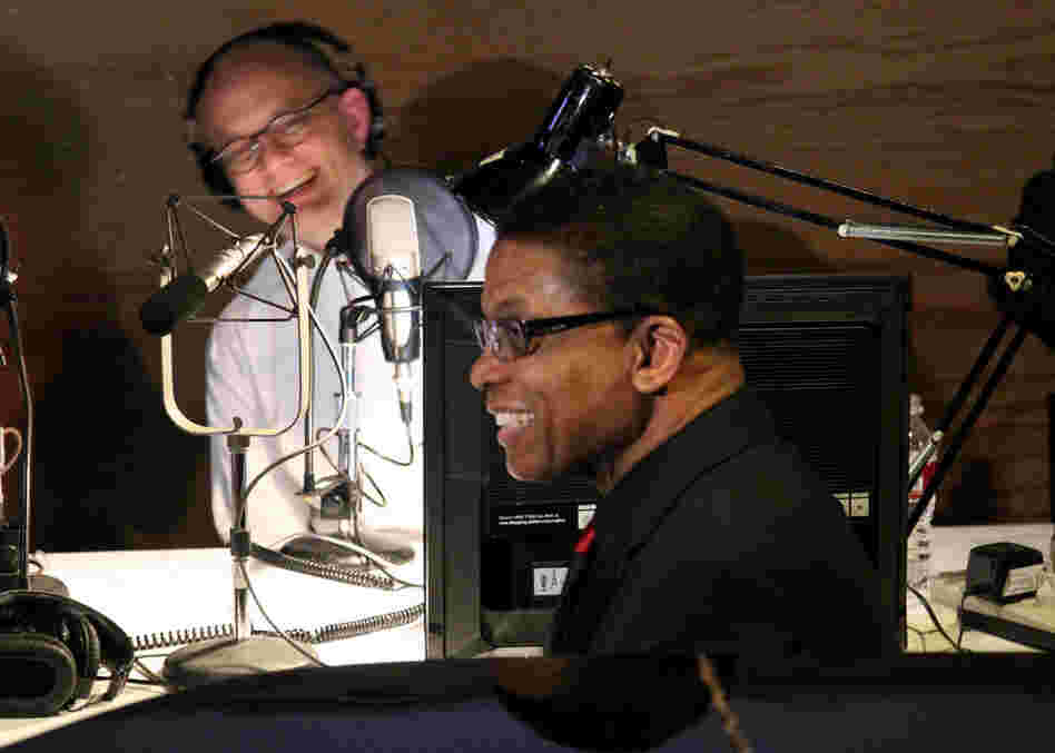 Pianist Herbie Hancock shares a laugh with American Public Media's Brian Newhouse backstage before his performance.