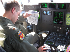 Air Force Maj. Josh Frey pilots a plane running on jet biofuel. Frey says his  C-130 flies the same on 50 percent biofuel as it does on petroleum.