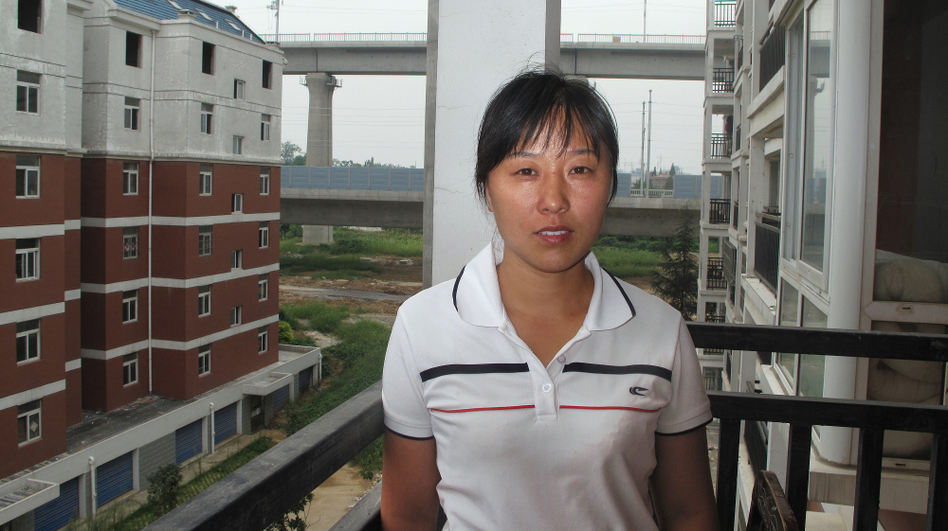 """Sun Miankou didn't know the high-speed rail would pass overhead until they began building the pillars outside her apartment. """"Of course I'm scared,"""" she says, but she's also angry. """"Two generations of my family worked to afford the apartment, and now the high-speed rail has been built right on top."""""""