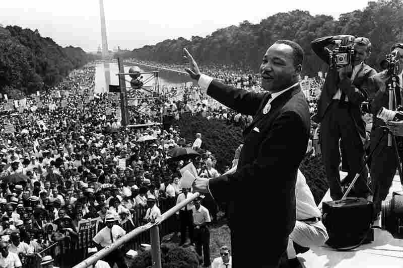 """Martin Luther King Jr. waves to supporters on the Mall during the March on Washington, where he later delivered his famous """"I Have a Dream"""" speech."""