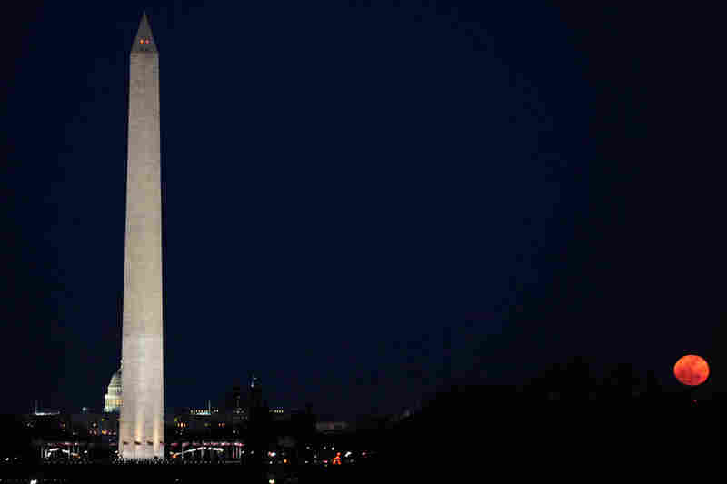 A perigee moon rises next to the Washington Monument on March 19. A perigee moon is visible when the moon's orbit position is at its closest point to Earth during a full moon phase.