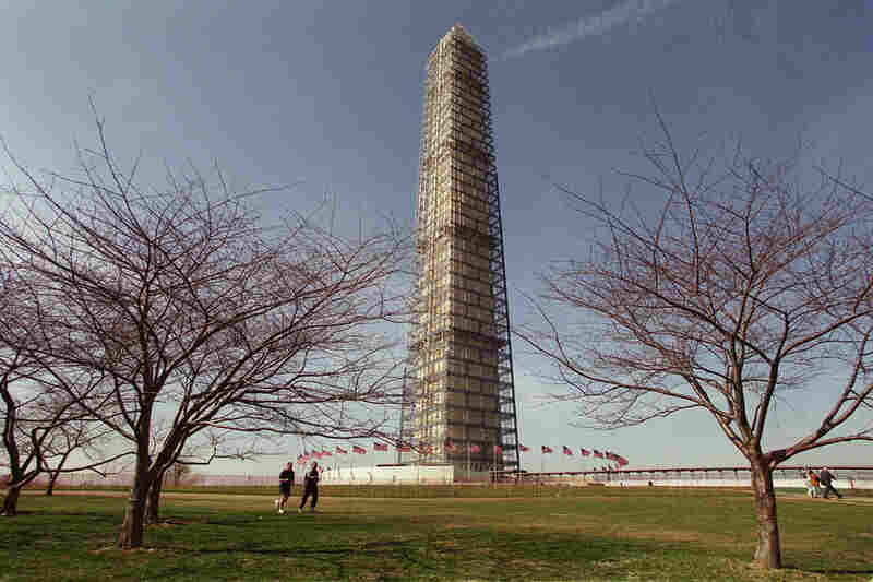 In 1996, the Washington Monument Restoration Project began; it took four years and $10 million. Here, the monument is covered in project scaffolding, in 1999.