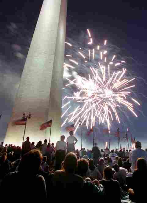Spectators watch the Independence Day fireworks in 1996 at the grounds of the monument.