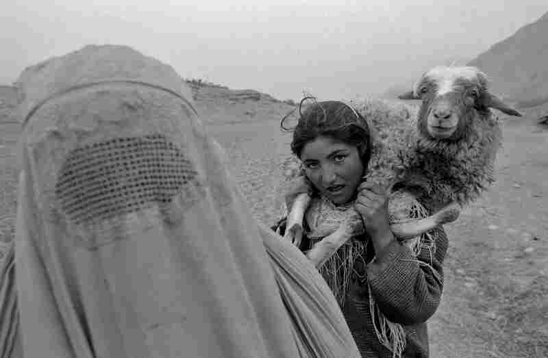 A mother and daughter returning home from work in the fields, Badakhshan Province, 2004.