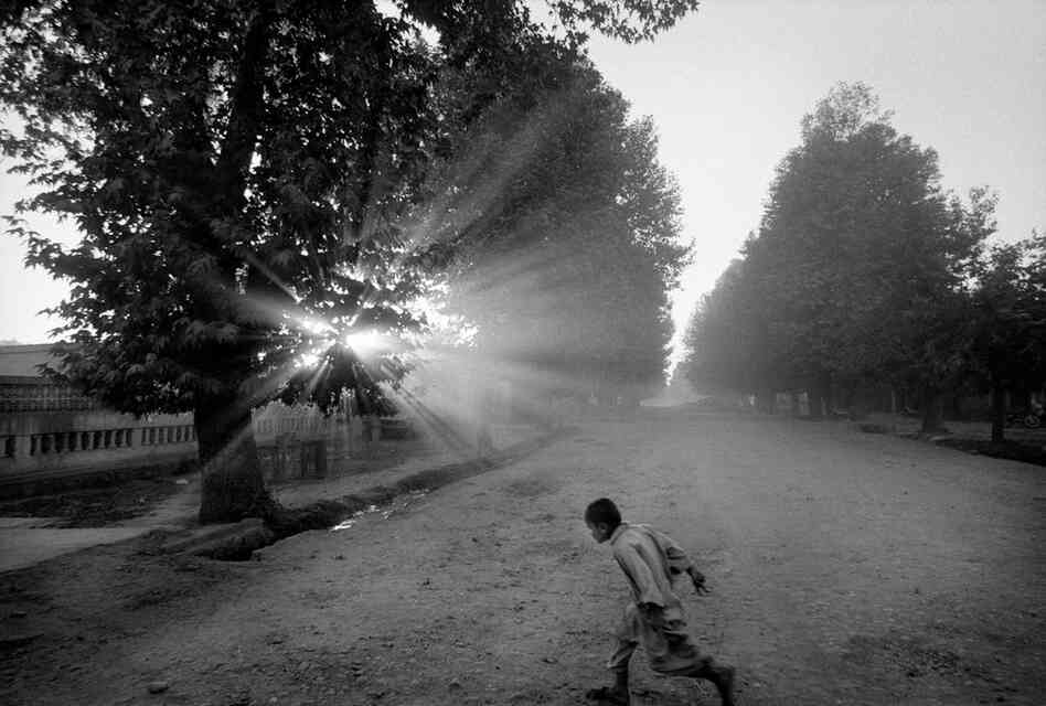 Returning home before night falls, Takhar Province, 2004