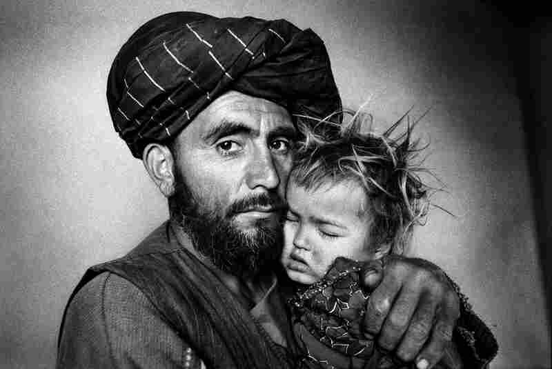 A father with his ill daughter waits for treatment at a Swedish Committee clinic, Takhar Province, 2000.