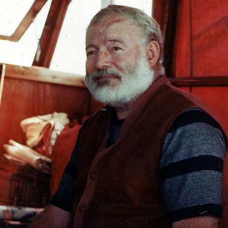 Ernest Hemingway sits in the cabin of his boat, Pilar, off the coast of Cuba.