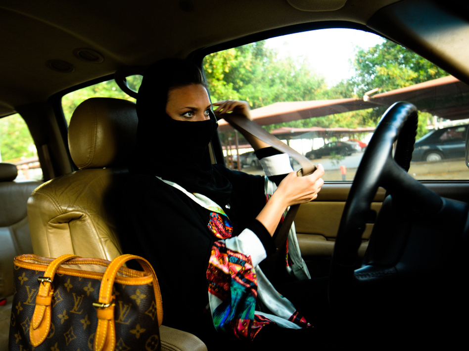 A Saudi woman fastens her seat belt before driving in Jeddah, western Saudi Arabia.