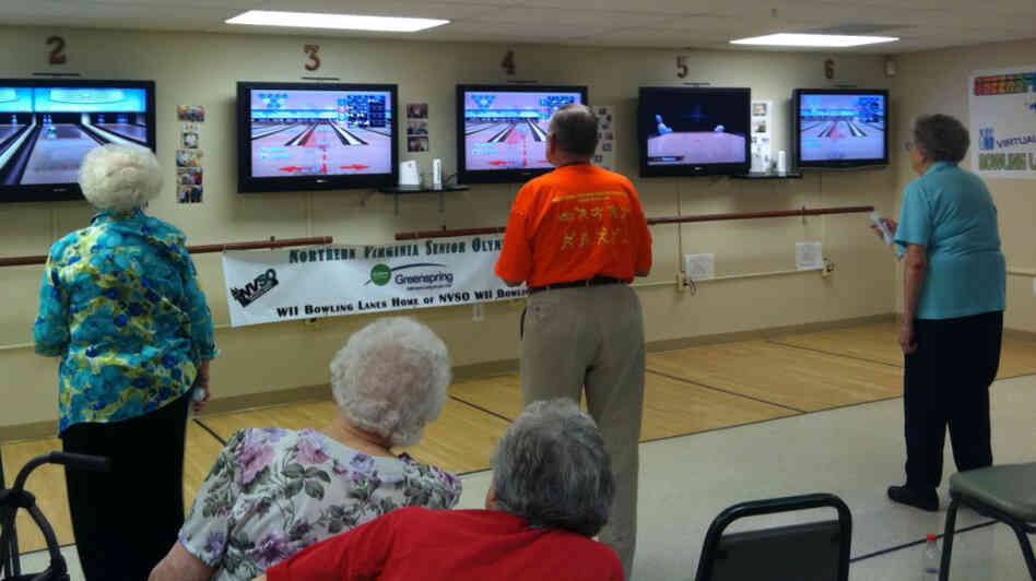 Seniors at the Greenspring Village Retirement Community in Springfield, Va., play Wii bowling.