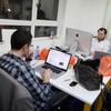 Small startup companies have an advantage, says author Eric Ries: they can test innovative ideas quickly. Here, workers in London talk at TechHub, an office space for technology entrepreneurs.